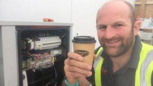 holding a coffee at m&s fuel station